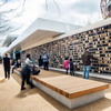 Playful Pavilion Attracts Visitors With Charred Timber, Alucobond, And Interactive Pixel Wall