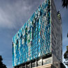 Colorful Aluminum Exterior Mimics Cascading Waterfall In Lively Mixed-Use Design