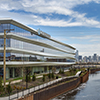 Undulating ALUCOBOND® Plus 'Fins' Reflect Water Movement, Reduce Glare in Energy-Efficient Riverfront Office Building