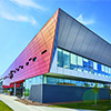 Health Center Serves as Glowing Neighborhood Beacon with Color-Shifting ALUCOBOND® Plus Cladding
