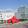 Shimmering Red Petal Retail Pavilion Draws Customers Inside Like Bees To Flowers With Color-Shifting ALUCOBOND® PLUS